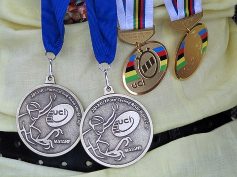 Four gold medals that Shelley won at World Cup 3 and the World Championships
