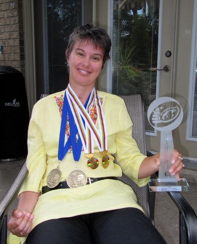 Shelley with her metals and trophy