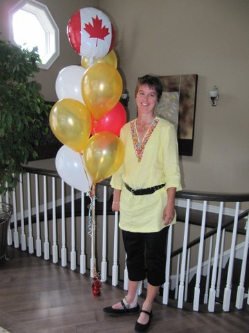 Shelley with red and white balloons for Canada and 4 yellow balloons to represent her gold medals